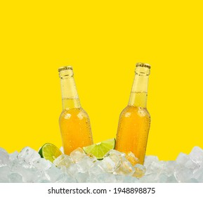 Close up two clear glass bottles of cold lager beer on ice cubes at retail display isolated on yellow background, low angle side view - Shutterstock ID 1948898875