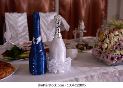 Close up two decorated wedding champagne bottles