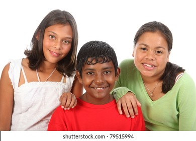 Close up of two girls and a boy relaxed  and smiling in studio