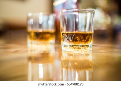 Close up two glasses of whiskey on table