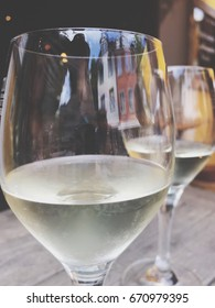 A close up of two glasses of white wine (Riesling) on the wooden table