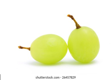 Close up of two green grapes isolated over white background.
