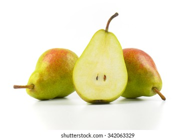 close up of two and half ripe pears on white background