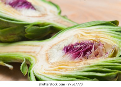 close up of two halved artichokes