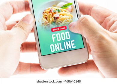 Close up Two hand holding mobile phone with food online word and icons, Digital Marketing concept.