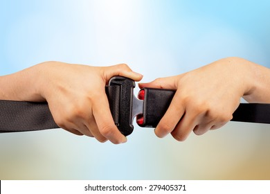 close up two hand use safety belt on colorful blurred background,clipping path