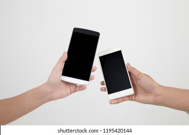 close up of two hands  holding smart phone