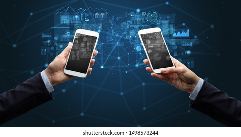 Close up of two hands holding smartphones to sync business data