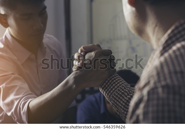 Close Up of two hands joining together, symbolizing to trust each other.