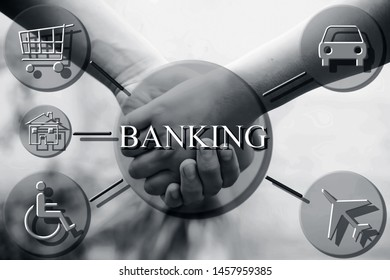 Close up of two human hand holding each other with some banking related icons and symbols.Concept of bakning and e finance along with baking security/safety.
