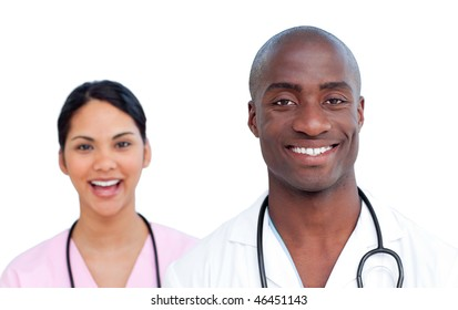 Close up of two jolly doctors against a white background