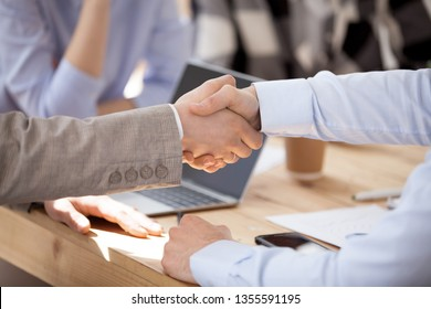 Close up two men shake hands at business meeting, office negotiations. Making deal sign, conclude contract, reach agreement, formal greeting, strike bargain. Successful negotiations, insurance concept
