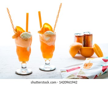 Close up of two orange soda creamsicle floats ready for drinking.
