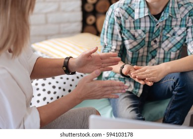 Close up of two pairs of hands while gesticulating