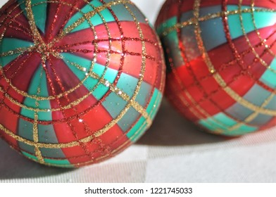 Close up of two plaid Christmas ornaments.