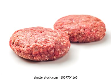 Close up two  raw red meat burgers for hamburgers of minced ground beef or pork ready for cooking isolated on white background.