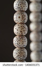 Close up of two strings of organic jewelry hanging up called rudraksha beads that are the material of malas,which is a rosary or used for prayer(japa)