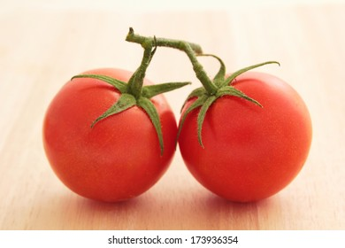 Close up of two tomatoes on the vine