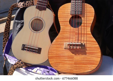 Close up of two ukuleles