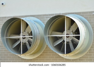 close up of two ventilation chimneys painted steel