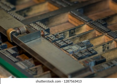 Close up of a typesetter with printing letters in an old printing house