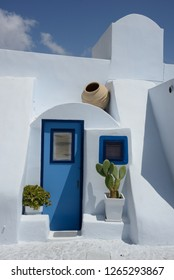 close up of typical modern white  and blu greek building with outside plants