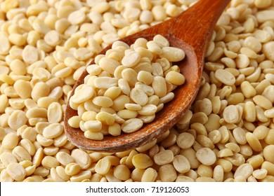 Close up of uncooked split de skined white Urad daal or lentils