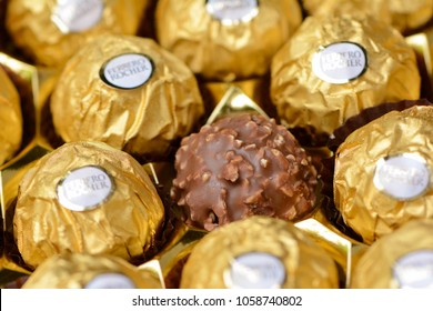Close up of uncovered and golden covered chocolate Ferrero Rocher in Bangkok, Thailand on 01 April, 2018.