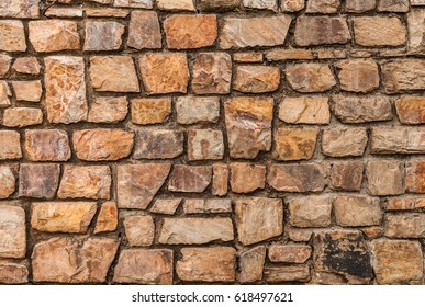 close up uneven real stone pattern brown color of vintage style design decorative  fence wall surface