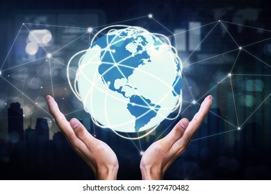 Close up of unknown hands holding an earth globe with network connection in virtual screen background