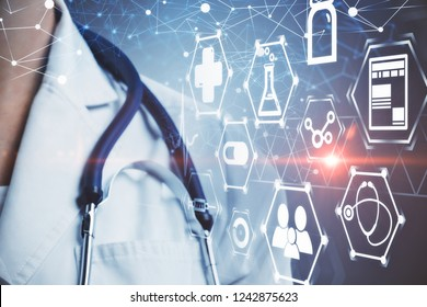 Close up of unrecognizable doctor standing over dark gray background with white glowing medical icons interface. Toned image double exposure