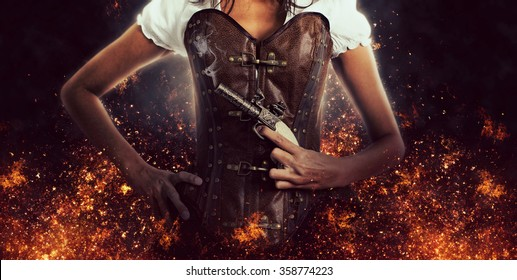 Close Up of Unrecognizable Woman Wearing Studded Brown Leather Corset and Holding Antique Pistol with Hand on Hip in Studio with Flaming Black Background