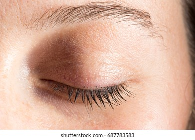Close uo of closed eye of woman
