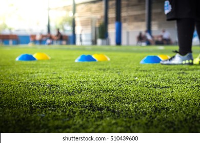 Close up, the artificial turf with a white stripe and a football