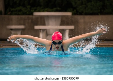 close up, Asian female is swimming with butterfly stroke.