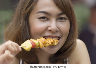 Close up, Asian woman enjoy to eating BBQ.