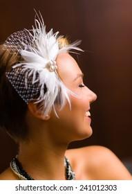Close up, attractive happy bride wearing to the head piece