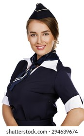 Close up, beautiful dark haired young business woman dressed in a dark blue suit with a blue scarf smiling, isolated on white background