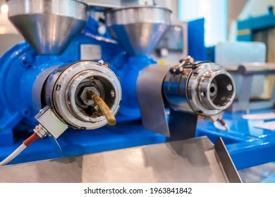 Close up: blue pet food extruder machine: mixed feed production line at factory, plant, exhibition, trade show. Farming, extrusion technology equipment, agriculture industry, animal husbandry concept