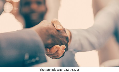 close up. blurry image of business people shaking hands.