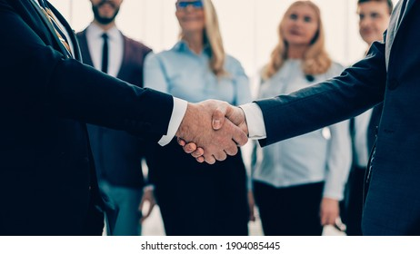 close up. business people shaking hands with each other.