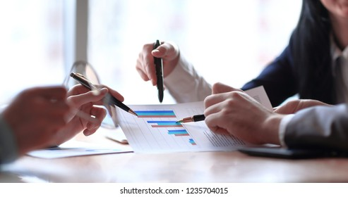 close up. the business team is discussing the financial profit of the company