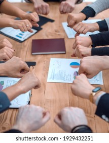 close up. the business team is making a circle of their hands over the desktop