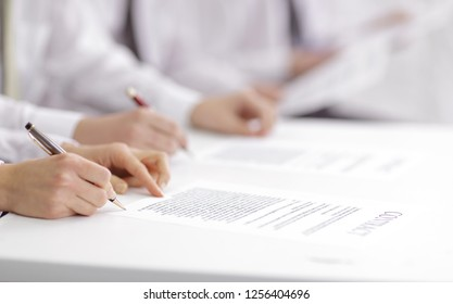 close up. business team studying the terms of the contract