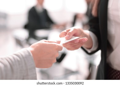 close up.two business woman exchanging business card