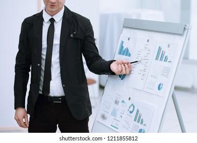 close up. businessman shows information on flipchart.
