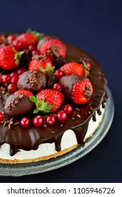 Close -up of chocolate cake decorated with fresh fruit