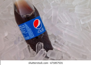 Close up, Cola bottle with ice cube, Brand name is PEPSI paste in the ice buckets, Photo taken on July 5, 2017 in Thailand.