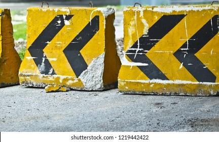 Close up. Concrete stone roadblocks
