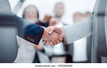 close up. confident business handshake on an office background.